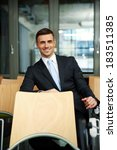 smiling businessman sitting at... | Shutterstock . vector #183511385