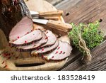 Tasting fresh piece of ham in a smokehouse - stock photo