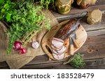 Fresh smoked ham in pantry - stock photo