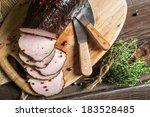 Closeup of fresh smoked ham in pantry - stock photo