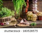 Smokehouse ham preparation for smoking in countryside - stock photo