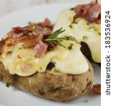 Baked Potatoes With Cheese And...