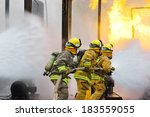 group of firefighters advance... | Shutterstock . vector #183559055