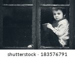 Boy On The Window  Smiling And...