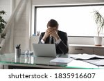 Small photo of Unhappy young male manager covering head with hands, suffering from pressure at work or feeling unwell due to overload. Overworked stressed businessman workaholic having headache, needs rest.