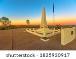 Anzac Hill War Memorial with is most visited landmark in Alice Springs, Northern Territory, Central Australia. The lookout offers a panoramic view of the town at twilight sunset.
