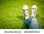 youth sneakers on girl legs on... | Shutterstock . vector #183600314