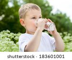 child drinking pure water in...   Shutterstock . vector #183601001