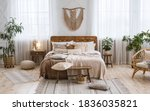 Small photo of Rustic home design with ethnic decoration. Bed with pillows, wooden furniture, plants in pots, armchair and curtains on large windows in cozy bedroom interior, nobody, flat lay, panorama, free space