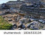 Small photo of Facade of a stone wall. Ruins of an ancient settlement. Kalos Limen (ancient Greek Κᾰλός Λ�μήν) is an ancient Greek city in the north-west of Crimea, which existed since the 4th century. BC.