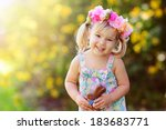 cute easter girl with chocolate ... | Shutterstock . vector #183683771
