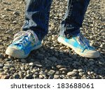 kid legs with gym shoes on... | Shutterstock . vector #183688061
