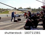 Birmingham Alabama USA - April 10, 2011: Pit stop action as teams change tires and refuel the race cars. - stock photo
