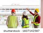 Three civil engineers team with ...
