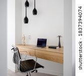 Small photo of Simple wooden desk with drawers in home office room with comfortable chair and ceiling lighting