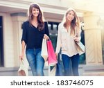 Beautiful Girls With Shopping...