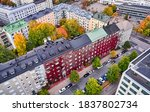 Small photo of Aerial view of the old apartment building. The red Virginia creeper on the building wall. The autumn cityscape, Helsinki, Finland.