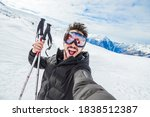 Happy Skier Taking A Selfie At...