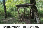 Wooden camp site for shepherds and hunters in the Caucasian wild mountain forest - stock photo