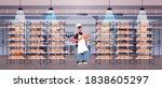 male baker in uniform holding... | Shutterstock .eps vector #1838605297