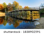 Small photo of The North Bridge, often colloquially called the Old North Bridge in Concord, Massachusetts at sunset. The bridge is a historic site in Concord, Massachusetts spanning the Concord River.