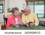 an elderly couple try to figure ... | Shutterstock . vector #183908915
