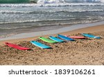 Colorful Surfboards On Beach....
