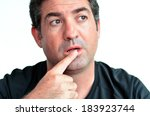mature man thinking with one... | Shutterstock . vector #183923744