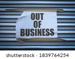 Small photo of Grungy Out Of Business Sign On Some Old Store Shutters, A Consequence Of The 2020 COVID Pandemic