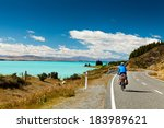 Cyclist Rides Along The Windin...