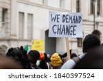 protester holding a  we demand... | Shutterstock . vector #1840397524