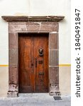 A Very Old Wooden Door With A...