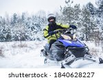 Man Driving Snowmobile In Snowy ...