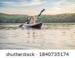 Man And Woman Swims On Kayak...