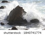 Waves Hitting A Rock With Spray