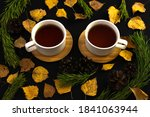 Two Tea Cups On Black...