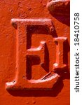 Small photo of A found letter, part of an entire alphabet, seen on an English pillar box. Suitable for use as part of a headline or as a drop capital at the beginning of a paragraph.