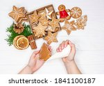 Woman Hands Paint Ornaments On...