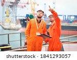 Two Sailors In Orange Overalls...