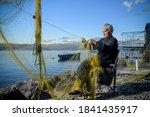 Senior Fisherman Holding...