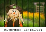 Scarecrow Against Iron Fence In ...