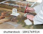 Hands Of A Restorer With A...