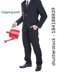 Businessman holding red watering pot for delopment something with Clipping path - stock photo