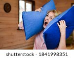 Small photo of woman covered ears with pillow. Noisy neighbors make it difficult to live peacefully. woman was tired of loud neighbors and covered ears. Harmful neighbors.
