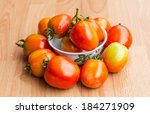 tomatoes on wooden background    Shutterstock . vector #184271909
