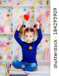 happy little girl draws with...   Shutterstock . vector #184295909