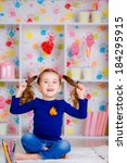 happy little girl draws with...   Shutterstock . vector #184295915