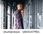 a man in a checked shirt stands ... | Shutterstock . vector #1843147981