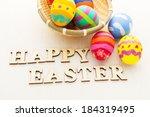 colourful easter egg in basket   Shutterstock . vector #184319495