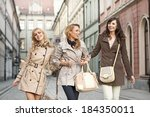 group of joyful girlfriends... | Shutterstock . vector #184350011